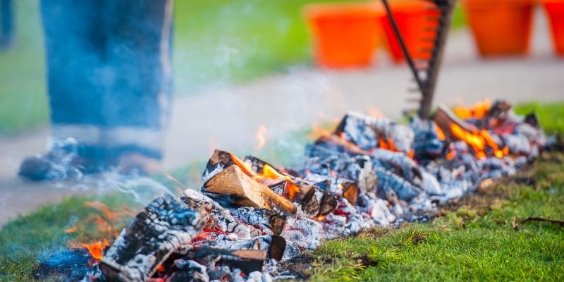 Hot coals being prepared for a firewalk
