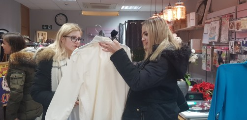 Photo 2 Harlow College students peruse a large collection of vintage and retro clothing and accessories at Scarlet