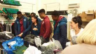 Photo 5 West Ham under 23s visit St Clare charity shop in Harlow to help sort donations