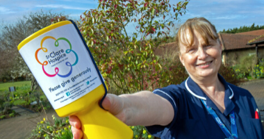 Nurse Anne with collection tin