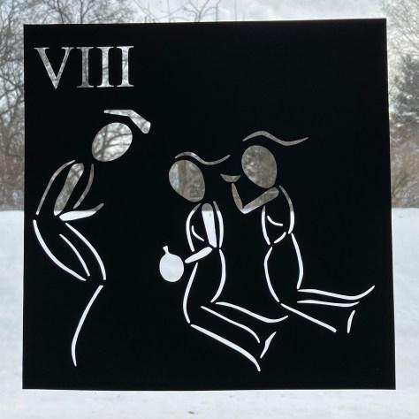 Paper cut image shows man meeting two kneeling women.