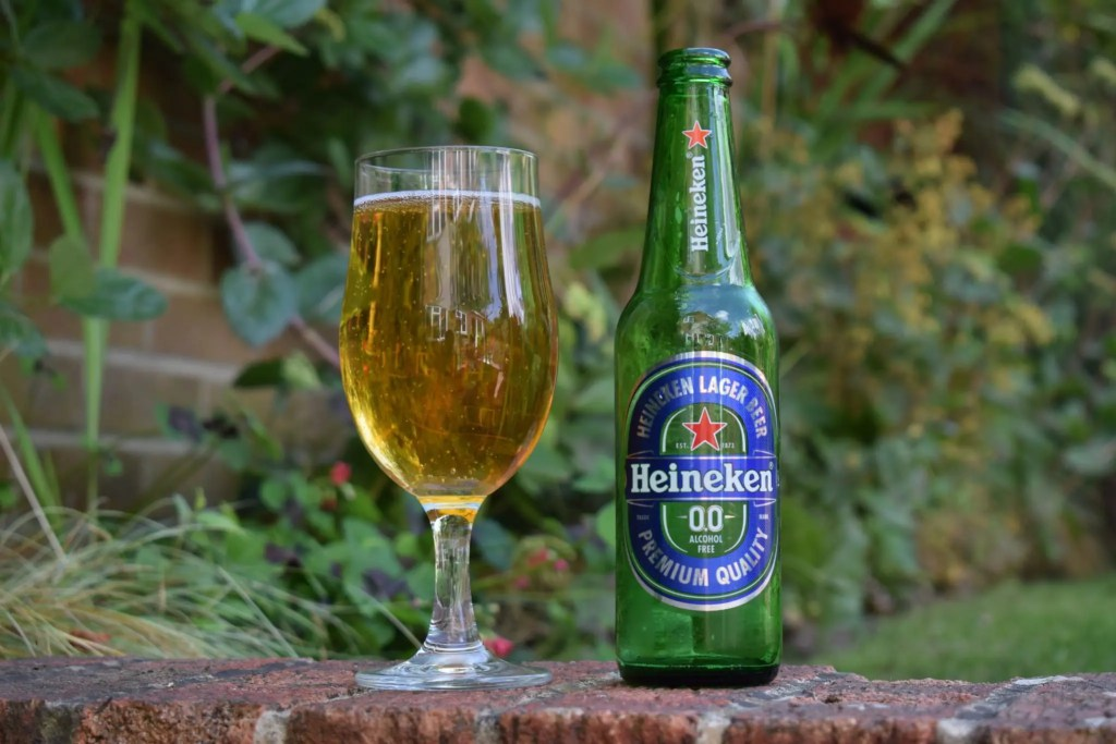 Bottle of Heineken 0.0 alcohol-free beer in glass