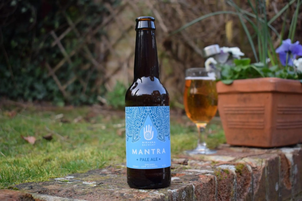 Nirvana Organic Mantra Pale Ale Alcohol-Free Beer - bottle and glass in background