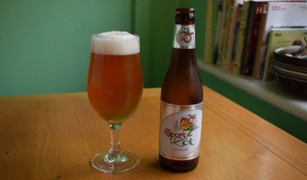 Bottle of non-alcoholic Sport Zot Belgian beer with glass
