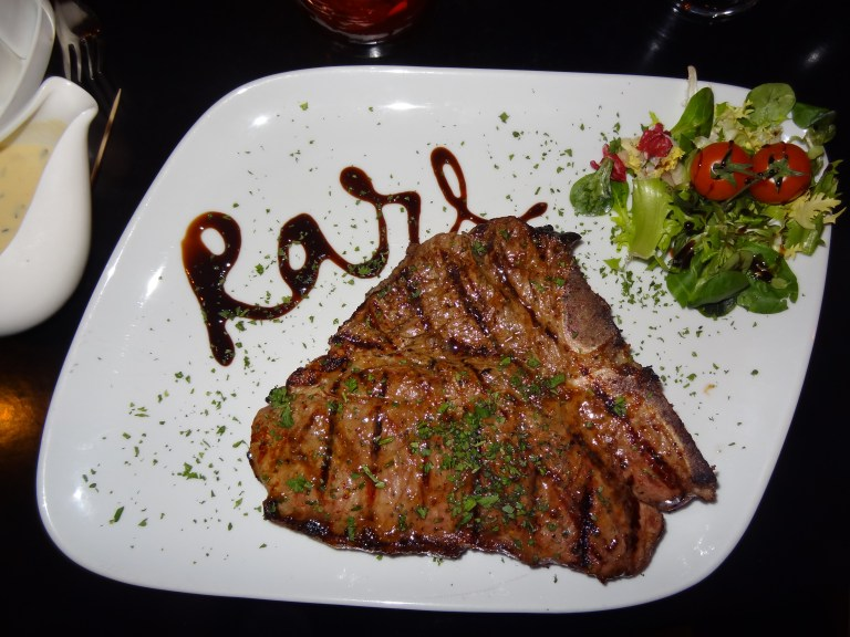 An image of a T-bone steak at Rare Steakhouse
