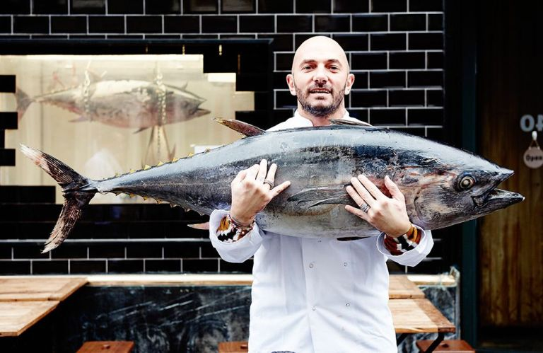 An image of Roberto Costa from Macellaio RC holding a blue fin Tina