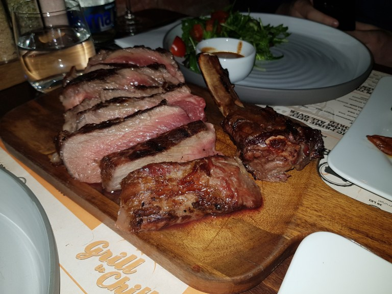 An image of tomahawk steak at grill to chill