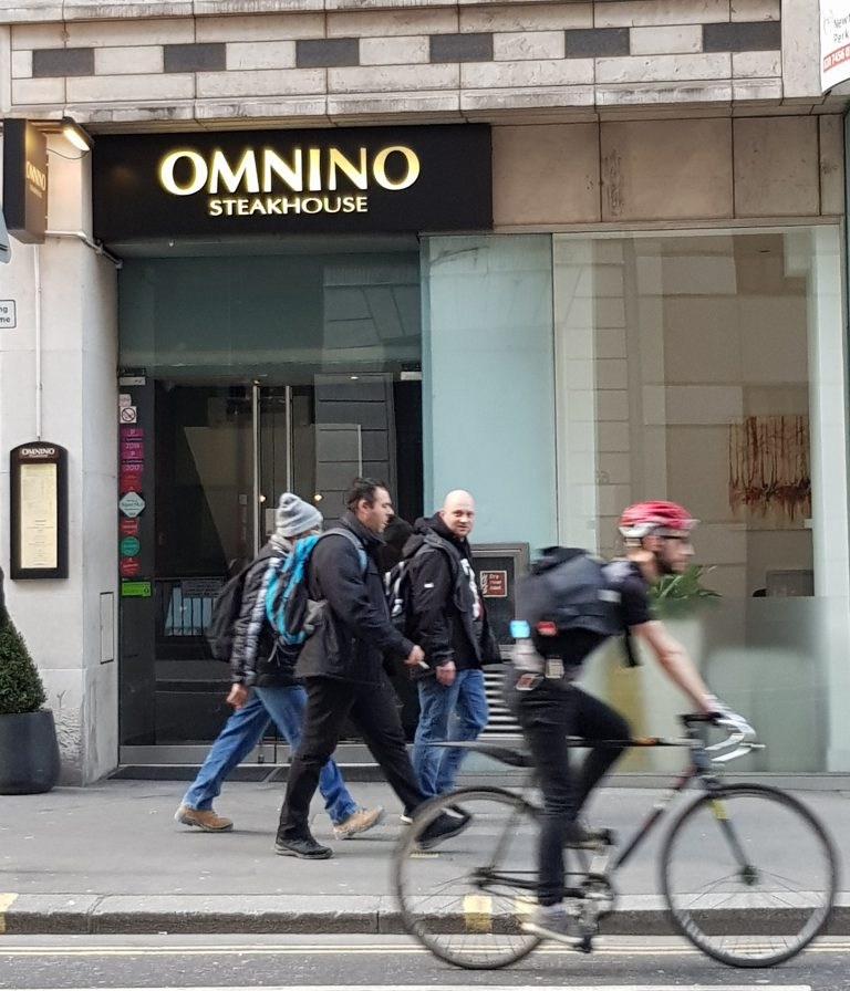 An image of the entrance to Omnino Steakhouse