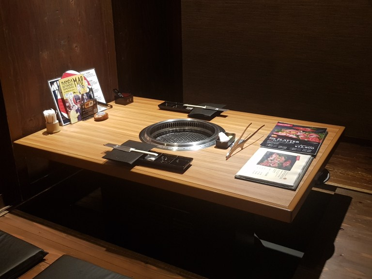 An image of a restaurant table with Yakiniku styled grill