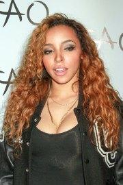 tinashe curly auburn angled hairstyle