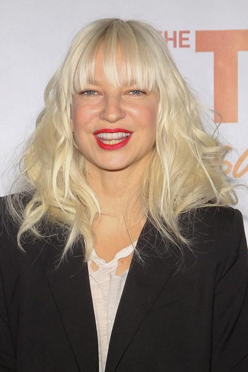 Sia Furler Wavy Platinum Blonde Thin Bangs Hairstyle