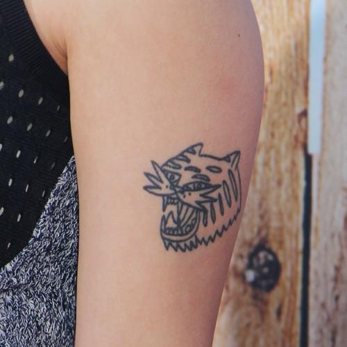 Small Upper Arm Arrow Tattoo