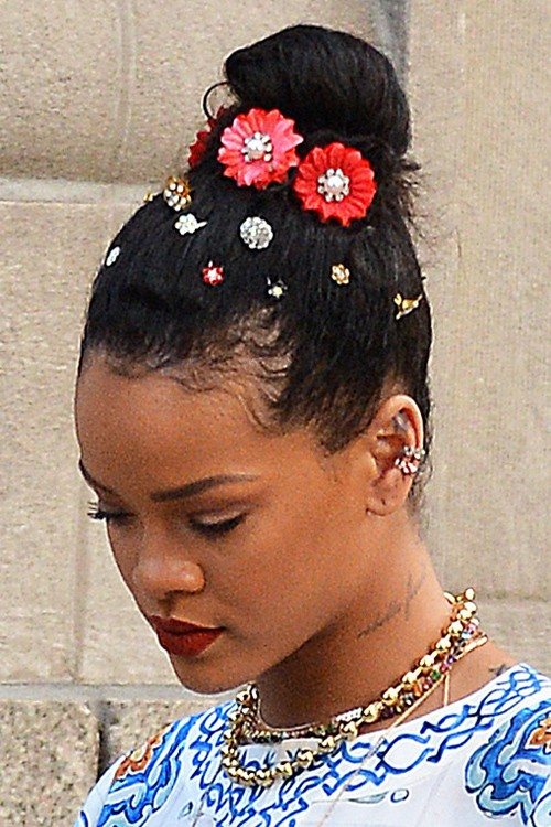 Rihanna Curly Teased Dark Brown Bun Hairstyle  Steal Her Style