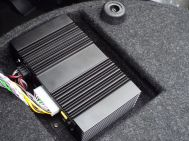Helix intentionally positioned the subwoofer port near the amp to aid in cooling...