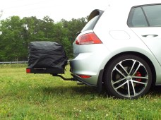 The hatch rubs on the bag in the zipped position, but it will open.