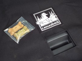 Canvasback's youngest employee, Caitlin, packs dog treats with each order...