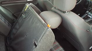 Headrest clearance against the front seatback...