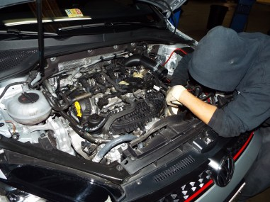 Removing the battery and intake tract to clear a path to the transmission...