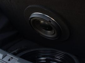 Yes, there is room for a 10-inch subwoofer AND a spare tire...