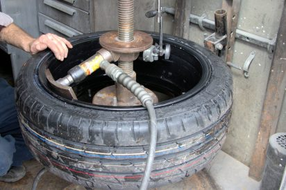 Using a hydraulic jack to bend the wheel back into alignment...