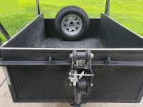 The winch is great for loading heavy items such as large roller tool cabinets...