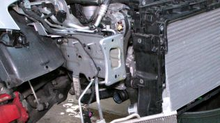 This is an old photo from my intercooler upgrade. Imagine the four bolts that attach the front impact bar to this frame rail. Now imagine the inch of bolt that protrudes through the back side of this flange. That is where the skid plate brace attaches...