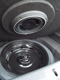 """There is nearly 2-1/2 inches of clearance between the highest point of this """"bolt"""" and the mounting face of the subwoofer. The metal trim ring extends less than 1.5″. In short, there is over an inch of clearance between the bolt and the static subwoofer."""