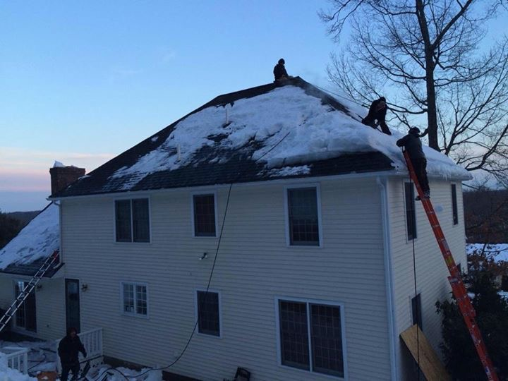 crazy House Ice Dam Removal