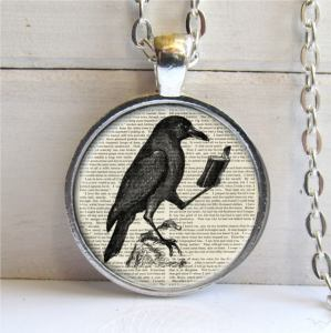 Silver Plated Reading Raven Pendent.