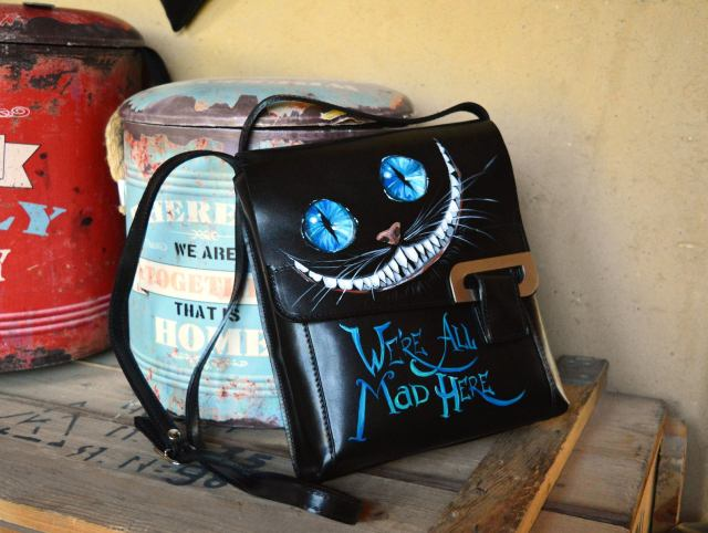 Cheshire Cat black leather briefcase. Were all mad here leather satchel