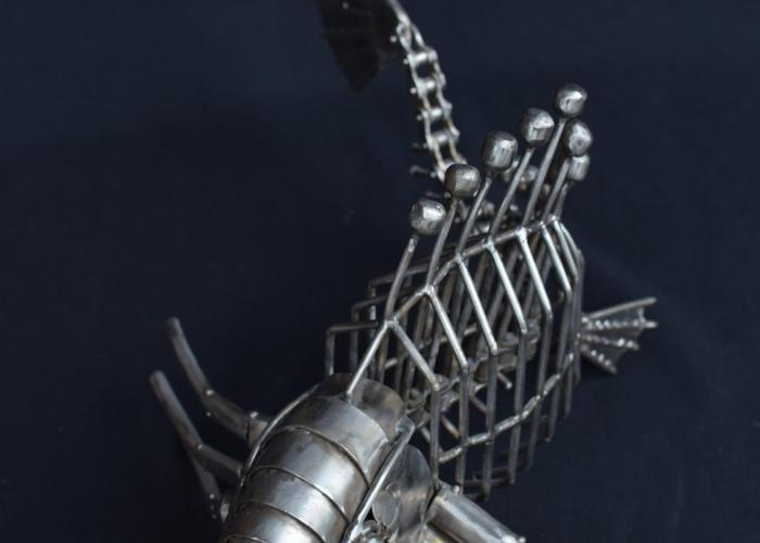 """Steampunk skeleton fish monster stainless steel metal sculpture abstraction. The underwater king of beauty."""