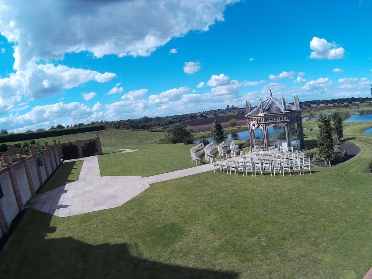 Steelasophical steelband wedding day music outdoors at The Old Hall Ely