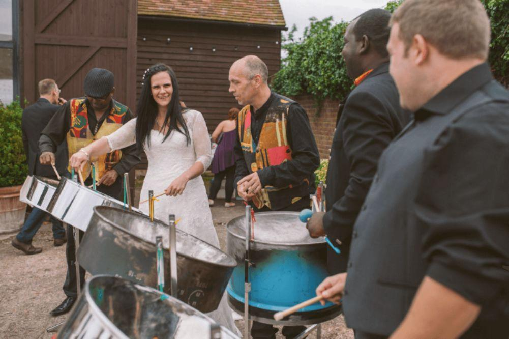Evrod Cottoy performing with Steelasophical steelpan band 1 Monkton Barn
