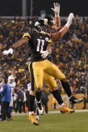 Pittsburgh Steelers wide receiver Markus Wheaton (11) celebrates his touchdown catch with tight end Jesse James (81) during the first half of an NFL football game against the Indianapolis Colts, Sunday, Dec. 6, 2015, in Pittsburgh. (AP Photo/Don Wright)