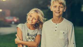 boy standing beside girl outdoors