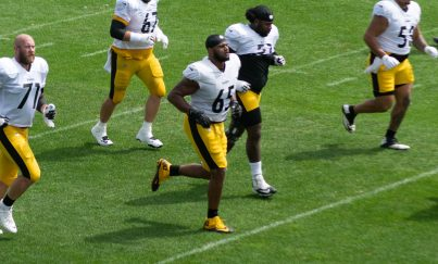 Rookie Dan Moore Jr. jogs with the offensive line at practice on Monday, Aug. 30, 2021. -- Alan Saunders