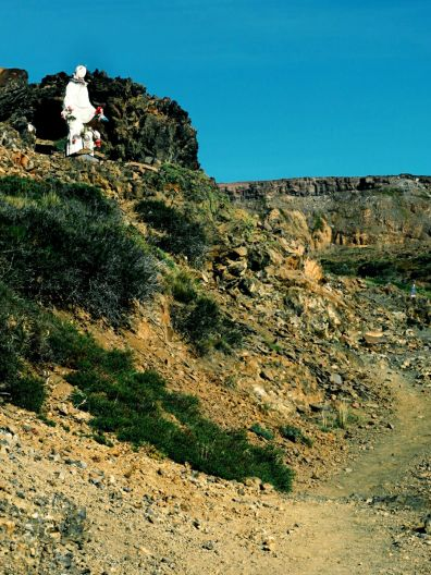 Trail to the pass, its start and the town watched over by the Virgin Mary.