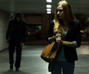 Photo of man stalking woman