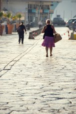 Woman walking along the harbourside