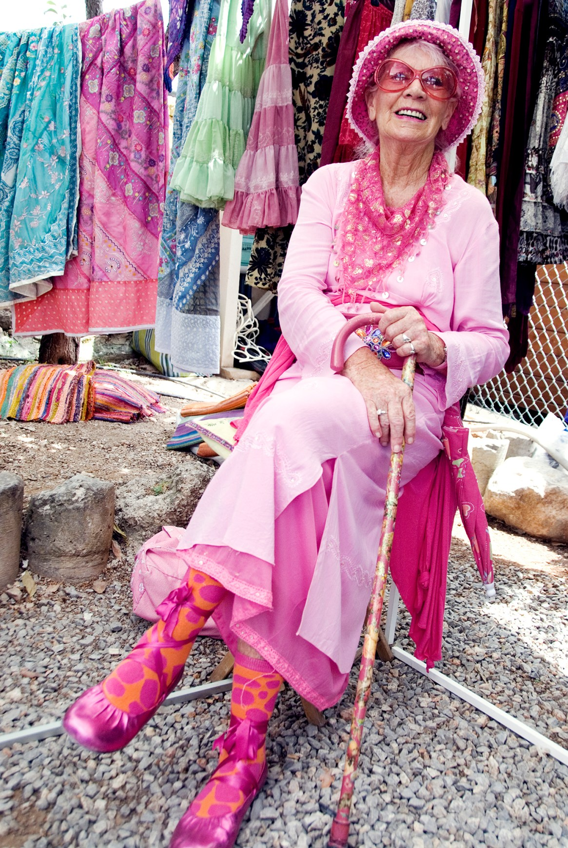 Busker Maryanne Kerr - dressed in pink - relaxes at the hippy market in Ibiza