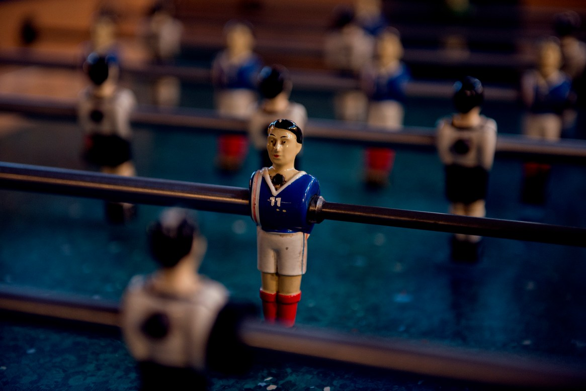 Close-up of a figurine on a foosball table