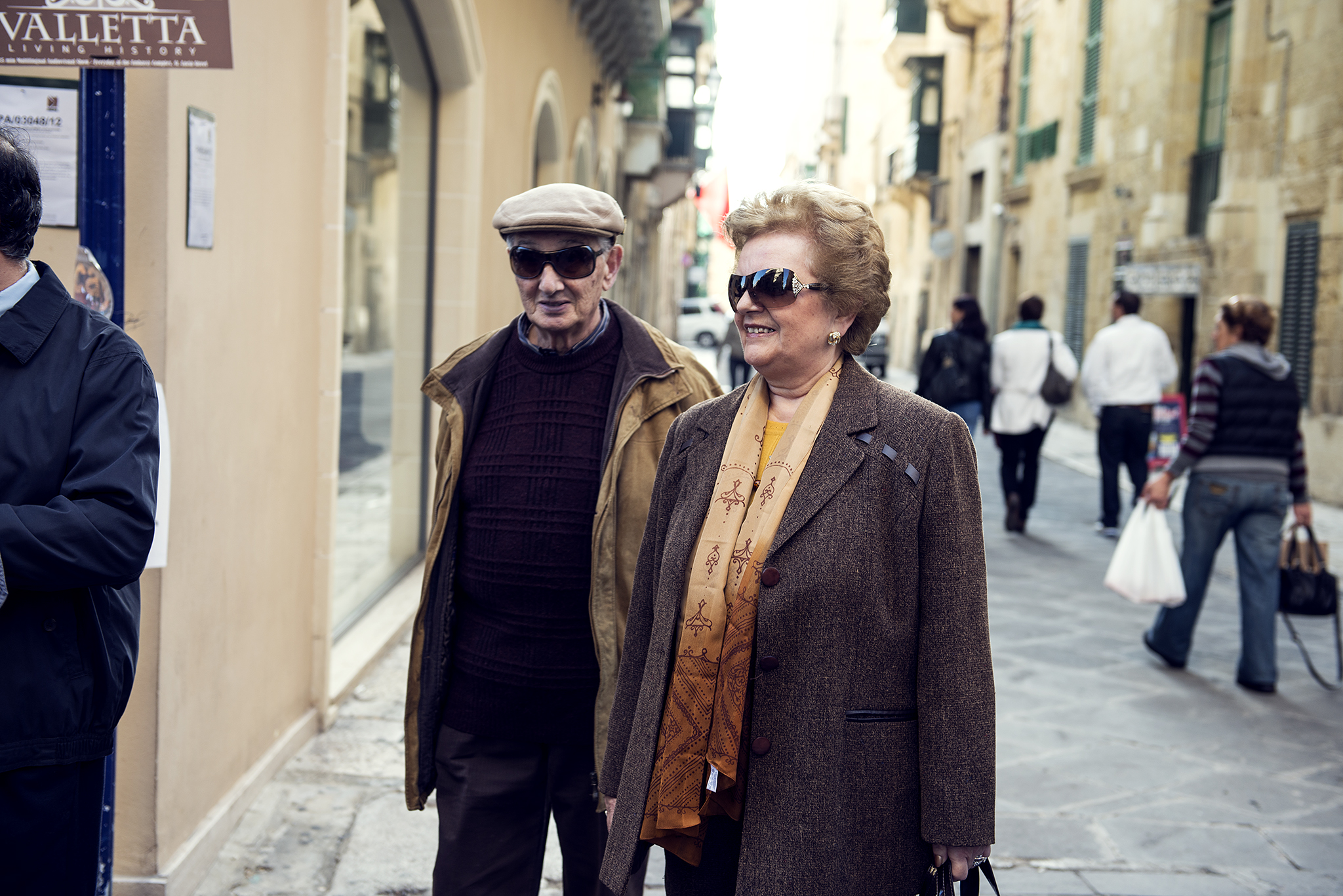 Elegant old man and woman walking down the street