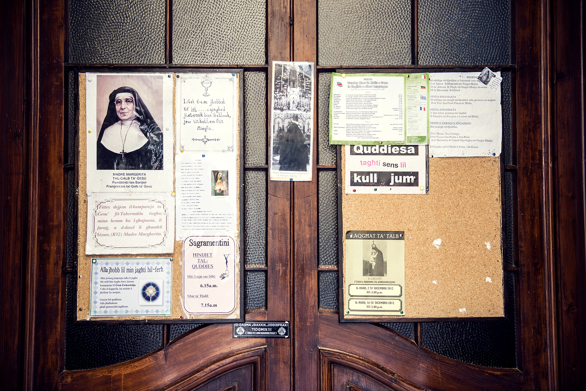 Church door with religious posters and notices