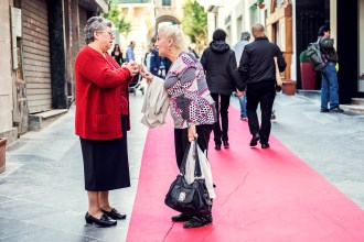 Two old woman talking in the street