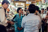 Politician being interviewed in a market