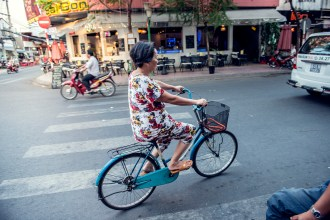 Woman riding her bicycle in Ho Chi Minh City