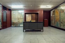 Map room with metal desk