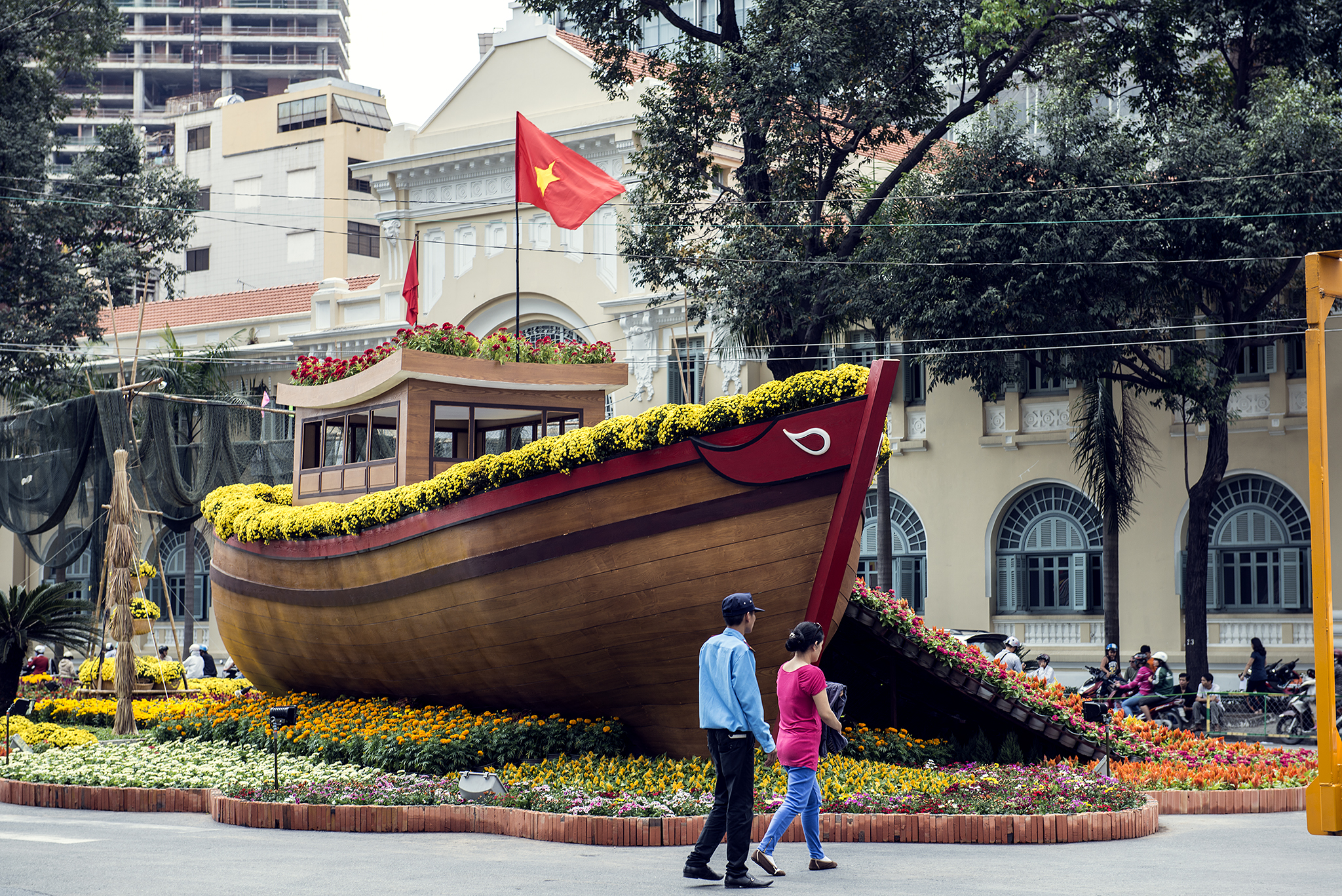 Wooden boat with yellow flowers and Vietnamese flag