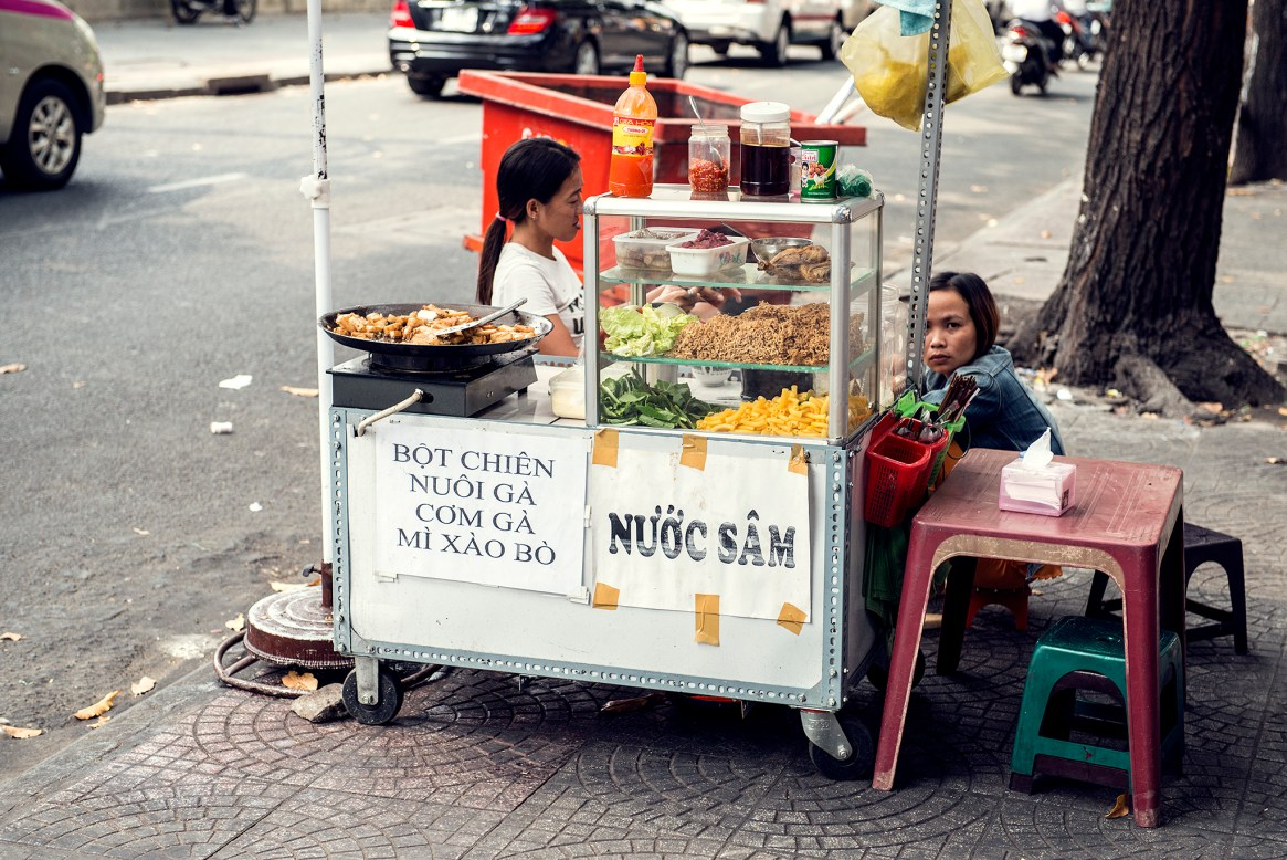 Two women selling food on the street in Ho Chi Minh City