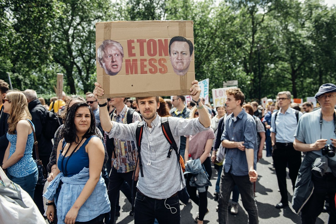 Man holds up banner at anti Brexit march